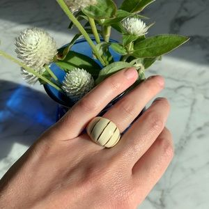 Gold and off-white ring